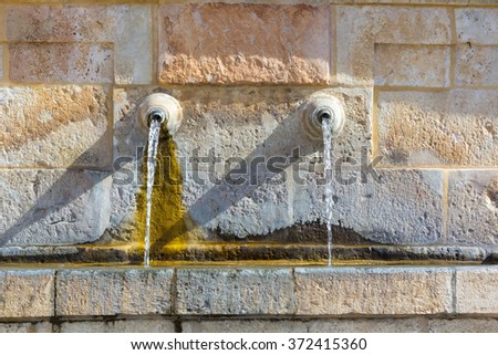 ancient water fountain water pipes - stock photo