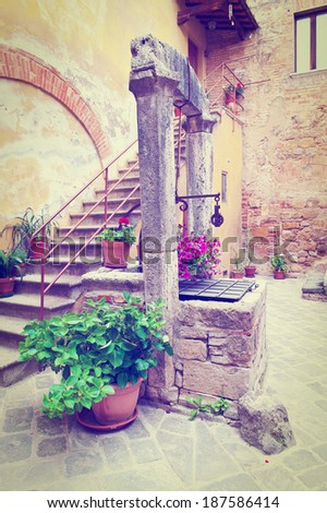 Ancient Well in Courtyard, Instagram Effect - stock photo
