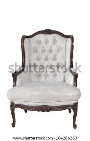 ancient white leather armchair whit white wall background.