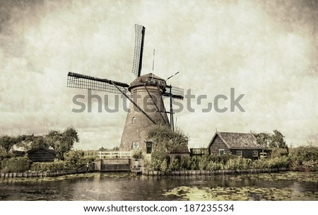 Ancient windmill in Kinderdijk, Holland. Stylization under an old card - stock photo