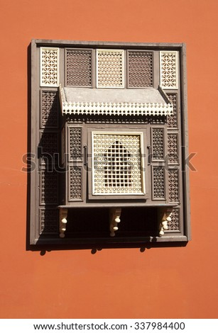 Ancient  window with decorative grid in a old Arab building