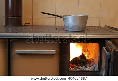 ancient wood-burning stove in the kitchen of mountain home