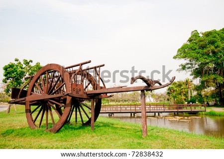 Ancient Wood Car in Thailand Garden. - stock photo