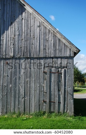 ancient wooden barn in Quebec Canada - stock photo