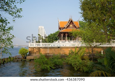 Ancient wooden Buddhist temple on the banks of the Chao Phraya River. Bangkok, Thailand - stock photo