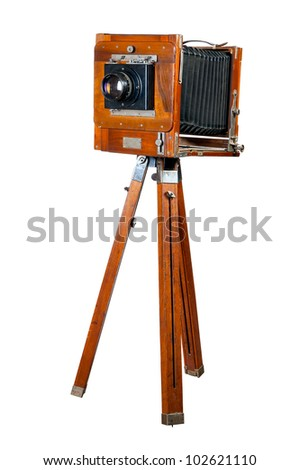 Ancient wooden camera. It is isolated on a white background - stock photo