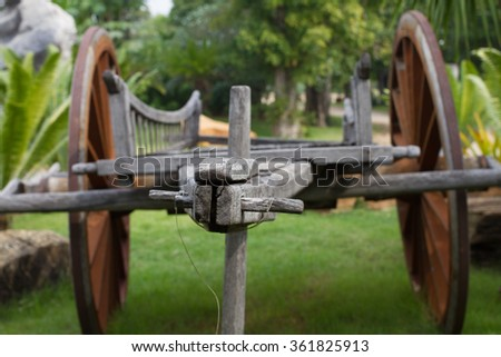 Ancient wooden cart, old wooden cart wheels