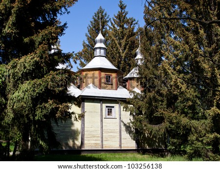 Ancient wooden church and pine tree