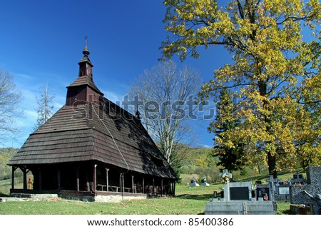 ancient wooden church in village Topola, Snina district, Slovakia. - stock photo