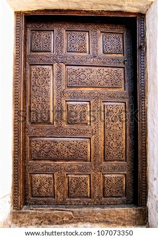Ancient wooden door in Khiva. Uzbekistan - stock photo