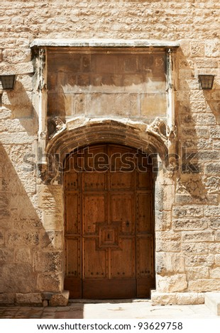 Ancient wooden door of medieval buildings in Aix en Provence, France