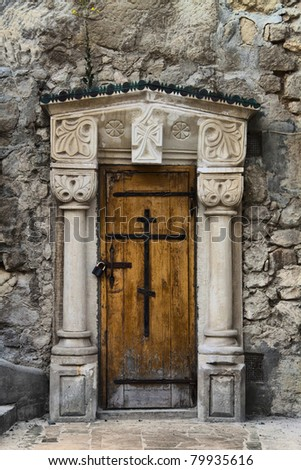 ancient wooden door to the church in Krimea Chufut Kale - stock photo
