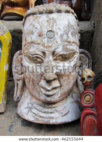 Ancient wooden mask Buddha, Nepal