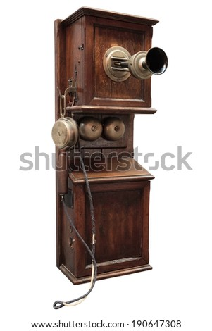 Ancient wooden phone, it is isolated on the white. - stock photo