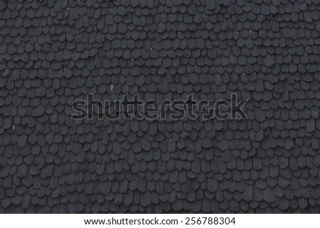 Ancient wooden roof tile on Northern Thai traditional home.  - stock photo