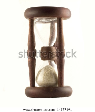 Ancient wooden sand-glass on white background