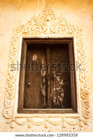 ancient wooden window in Thai church - stock photo