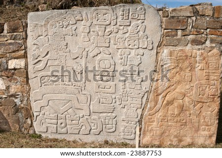 Ancient zapotec relief on the wall in Monte Alban, Mexico - stock photo