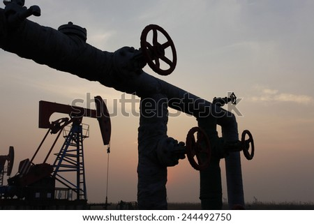 And at the scene of the oil field oil pipeline - stock photo