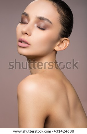 and beautiful young woman with soft and natural make-up, brunette with Zorov facial skin