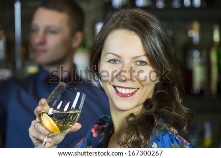 and the bartender girl near the bar