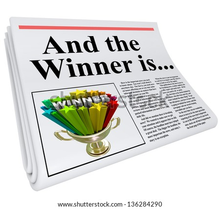 And the Winner Is headline on a newspaper with a photo of a winning trophy to celebrate and announce that someone won a competition, contest, raffle or other award program - stock photo