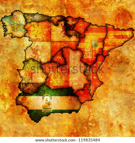 andalucia region on administration map of regions of spain with flags and emblems - stock photo