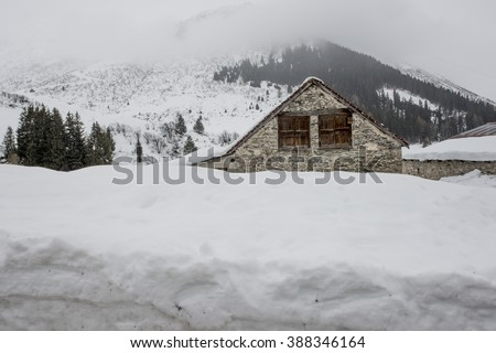 ANDERMATT, SWITZERLAND - FEBRUARY 23, 2016: High snow drifts in Andermatt
