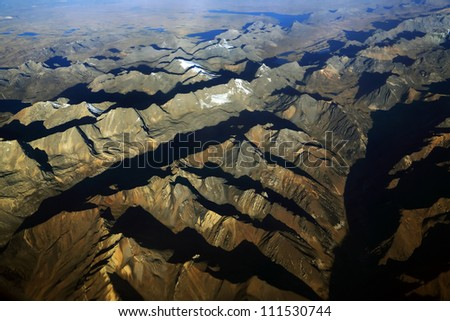 Andes Mountains seen from the plane, South America - stock photo