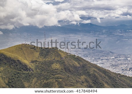 Andes range mountains landscape scene from the top of Cruz Loma hill  and cityscape of Quito,  Ecuador - stock photo