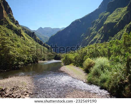Andes scenery with river in Peru near Cusco - stock photo