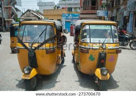 ANDHRA PRADESH, INDIA - MARCH 21: Busy streets of guntur, The rural parts of India still uses outdated transportation methods like auto rickshaws and tuk tuk ,MARCH 21,  2015 in Andhra pradesh, India. - stock photo