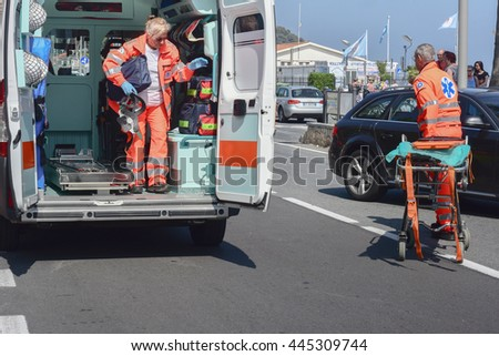 Andora (SV), italy June 26, 2016: Paramedics, give first aid assistance to the scooter driver was injured in a car accident.  - stock photo