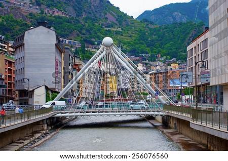 ANDORRA LA VELLA, ANDORRA - JULY 28:  Bridge through  Gran Valira river in  Andorra la Vella on July 28, 2014, Andorra.  - stock photo