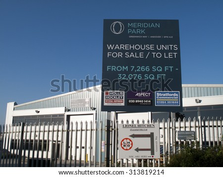 Andover, Greenwich Way, Meridian Park, Hampshire, England - September 6, 2015: Commercial warehouse units for sale or to let advertising sign - stock photo