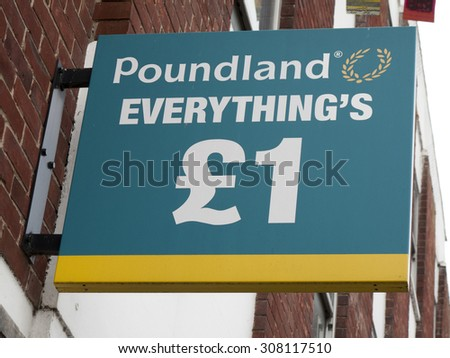 Andover, High Street, Hampshire, England - August 20, 2015: Poundland shop sign over premises, company founded in 1990 by Dave Todd and Stephen Smith - stock photo