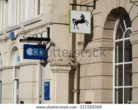 Andover, High Street, Hampshire, England - September 25, 2015: HSBC Bank and Trustees Savings bank sign over local branch offices - stock photo