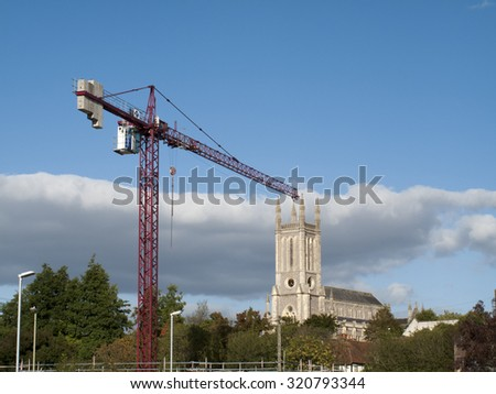 Andover, West Street, Hampshire, England - September 25, 2015: Tower crane working over construction site building retirement apartments, developer Churchill Retirement Living