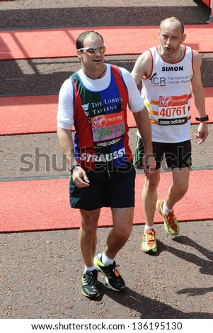 Andrew Strauss finishes the 2013 London Marathon on The Mall, London. 22/04/2013 Picture by: Steve Vas