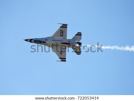 ANDREWS JOINT BASE, MD – SEPTEMBER 16: Thunderbird flying F16 jet at the Andrews Joint Base Air Show celebrating the 70th anniversary of the Air Force, on September 16, 2017.