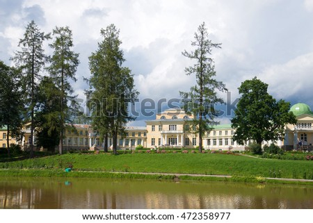 "ANDRIANOVO, RUSSIA - JULY 31, 2016: Cloudy july day in an old russian manor ""Maryino"". View of the facade of the manor house"