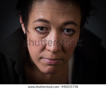 Androgen. Androgynous character on a gray background. Man or woman. Military style.