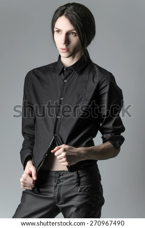 Androgynous beautiful young man. Model tests. - stock photo