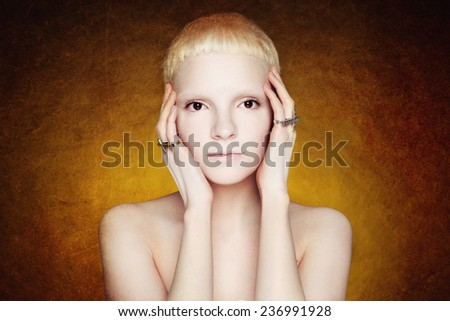 androgynous girl in the studio on textured background - stock photo