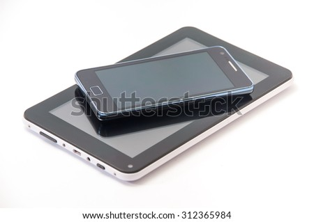 Android phone and android tablet on the white background. - stock photo