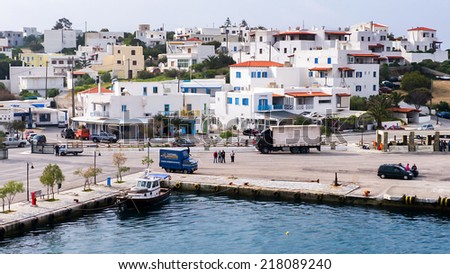 ANDROS, GREECE- APRIL 10, 2014: The town with port of Andros island, Greece. Andros is a Greek island situated in the Aegean Sea. It is located in the Cyclades archipelago.