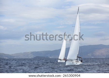 ANDROS, GREECE - CIRCA OCT, 2014: Sailboat participate in sailing regatta 12th Ellada Autumn 2014 among Greek island group in the Aegean Sea, in Cyclades and Argo-Saronic Gulf. - stock photo