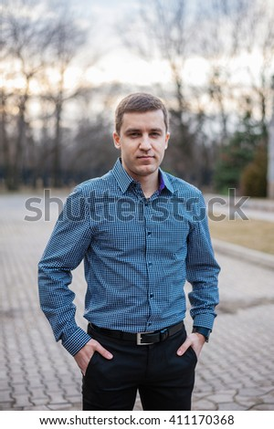 Andsome guy wearing shirt - stock photo