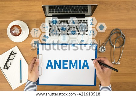 ANEMIA Top view, Doctor writing medical records on a clipboard, medical equipment - stock photo