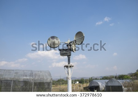 Anemometer in a farm with blue sky - stock photo